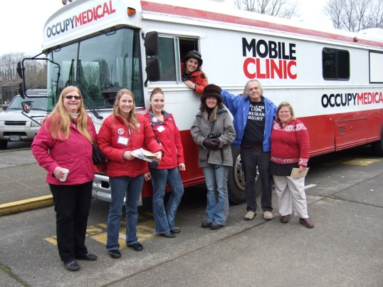 From left Rosalie, and Jessica (HCAO), unidentified healthcare advocate, and medical staff Andrea (in the driver's seat), Donna, Jerry and another unidentified healthcare advocate.